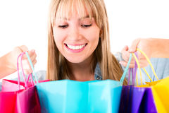 Woman looking at her purchases Royalty Free Stock Photography