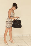Woman looking in her purse Stock Photography