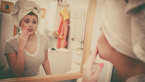 Woman looking at her reflection in mirror Stock Photography