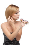 Woman looking at her reflexion in Stock Photography