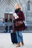 Woman looking for her route. Cheerful woman having a map and looking for her route in the city Stock Photography
