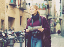 Woman looking for her route. Young woman having a map and looking for her route in the city Royalty Free Stock Images