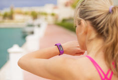 Woman looking at her smartwatch during workout Stock Photos