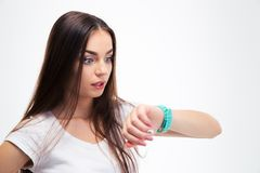 Woman looking on her watch Stock Photography
