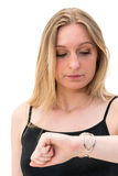 Woman looking at her watch Stock Images