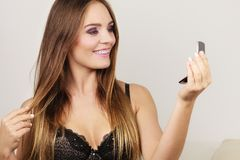 Woman attractive girl looking in mirror stock images