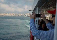 Woman looking at horizontal smartphone with green screen takes pictures. Close up shot of woman`s hands with mobile. Istambul, Tur. 10 August 2017, Istanbul royalty free stock photo