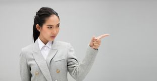 Woman looking an idea and pointing to left side copy space. Young Business Model Woman formal suit jacket looking an idea and pointing to left side copy space royalty free stock photos