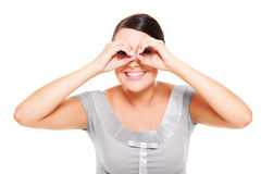 Woman looking through imaginary binocular Stock Photography