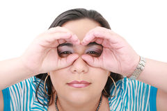 Woman looking through imaginary binocular Royalty Free Stock Images