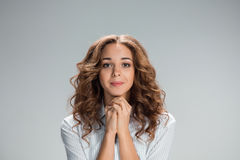 Woman is looking imploring over gray background Stock Photography