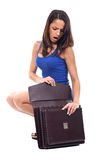 Woman looking inside a briefcase Royalty Free Stock Photography