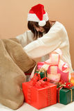Woman looking inside christmas sack Stock Images