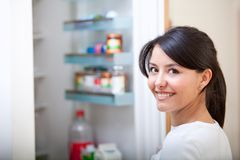 Woman looking inside the fridge Royalty Free Stock Photos