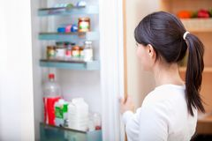 Woman looking inside the fridge Stock Image