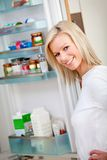 Woman looking inside the fridge Royalty Free Stock Images