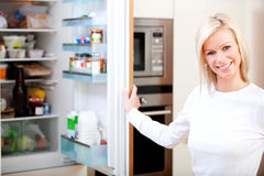 Woman looking inside the fridge Royalty Free Stock Image