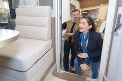 Woman looking inside motorhome Royalty Free Stock Photo