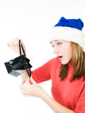 Woman looking inside shopping gift bag Royalty Free Stock Images