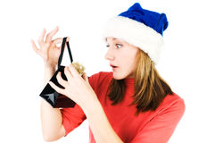 Woman looking inside shopping gift bag Stock Photos