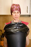 Woman Looking inside a Trash Can Royalty Free Stock Photography