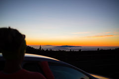 Woman looking at inspirational landscape ocean view. Woman looking at inspirational landscape and ocean view. Female car driver or passenger silhouette and royalty free stock photography