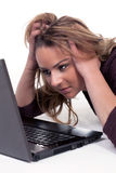 Woman looking intently at her laptop screen Stock Images