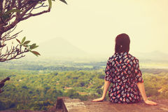 Woman looking on the landscape. Woman sitting and looking on the landscape Royalty Free Stock Photography