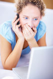 Woman looking at the laptop and getting surprised Royalty Free Stock Images