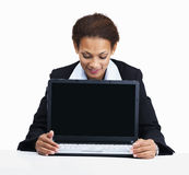 Woman looking at laptop on white background Royalty Free Stock Photo
