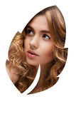 Woman looking through a leaf shape Royalty Free Stock Image