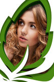 Woman looking through a leaf shape Royalty Free Stock Images