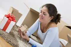 Woman looking for the little box Stock Photo