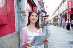 Woman looking for location in Macau city Royalty Free Stock Photo