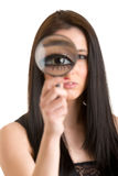 Woman Looking Through a Loupe Stock Photography