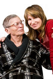 Woman looking with love at elderly father Royalty Free Stock Images
