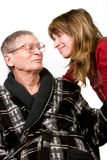 Woman looking with love at elderly father stock images