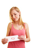 Woman looking at love letter Royalty Free Stock Photos