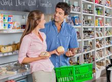 Woman Looking At Man While Buying Cheese Stock Image
