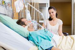 Woman Looking At Man In Hospital Royalty Free Stock Photography
