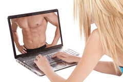 Woman looking at a man in laptop. A woman is using her laptop and looking at the chest of a man royalty free stock photography