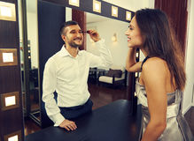 Woman looking at man in the mirror Stock Photography
