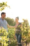 A woman looking at a man and smiling Stock Photos