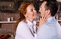 Woman looking at man with tender Royalty Free Stock Images