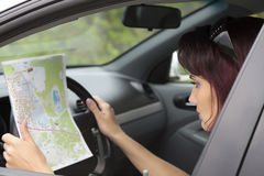 Woman looking at a map Stock Image