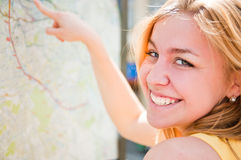 Woman is looking on a map Royalty Free Stock Photos