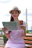 Woman looking the map Stock Image