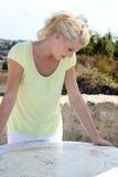 Woman looking at map Stock Photo