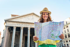 Woman looking at map in front of pantheon in rome Royalty Free Stock Image