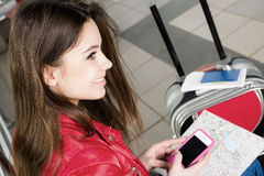 Woman looking at the map and telephone number. She is studying the route. Close-up Royalty Free Stock Photography